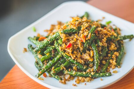 stir fried long beans with chilli and salted fish served on a  white plate Stok Fotoğraf