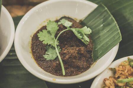 Ayam Buah Keluak Stewed chicken with whole nut megs Stock Photo