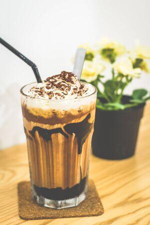 Iced Manhattan Mocha Chocolate sauce, milk, espresso, chocolate ice-cream, whipped cream
