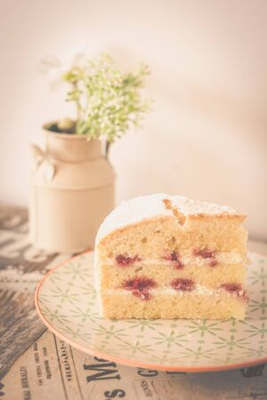 Victorain Sponge cake, a light three layered sponge cake with strawberry jam between layers and lightly dusted with icing sugar on top 写真素材