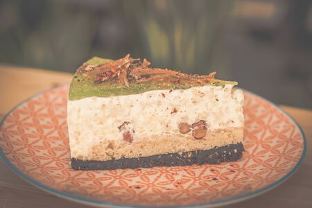nasi lemak (southeast asian coconut rice) cheesecake served in a colourful small plate 写真素材