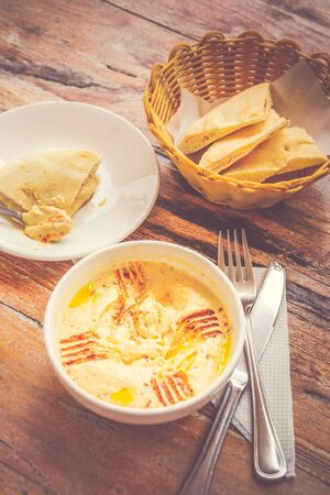 Hummus Pureed chickpeas, tahini, lemon, garlic drizzled with extra virgin oil served with pita bread