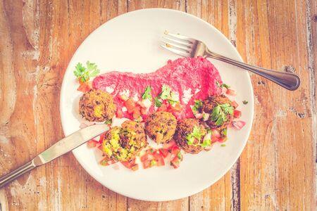 Green Pea Falafel Falafel ball served with tomato salsa and beetroot tahini puree