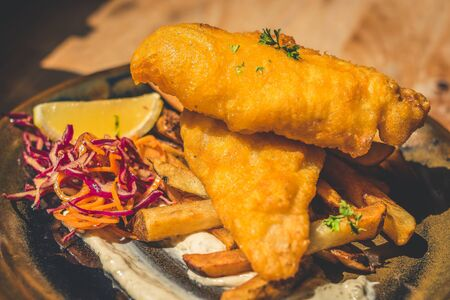 Atlantic Cod Fish And Chips Atlantic Cod is lean and white with a sweet, delicate taste which flakes tenderly.  Served with handcut chips, fresh slaw and housemade tartar. Фото со стока