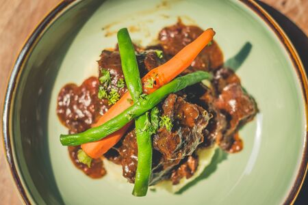 Cheeky Git Braised beef cheek stew with french beans and housemade mash