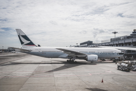 cathay pacific boeing 777 airplane parked in Singapore Changi Airport Terminal one