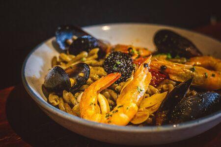 pasta with Sauteed Prawns, Salmon Caviar, Black Lump Fish Caviar, Blue Mussels, Calamari, Truffle Oil, Tom Yum Sauce