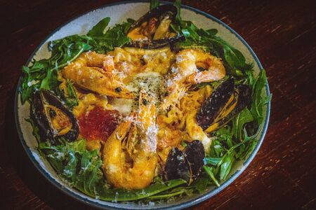 Pink sauce pasta (a mixture of Pomodoro and Carbonara), Grated Parmesan, Extra Virgin Olive Oil, Arugula, Sous Vide Egg, Calamari, Black Lump Fish Caviar, Black Truffle Pate, Prawns Stock fotó