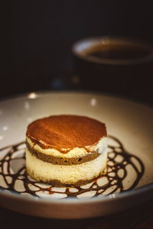 Tiramisu A rich treat blending the bold flavours of cocoa and espresso with mascarpone cheese and ladyfinger biscuits