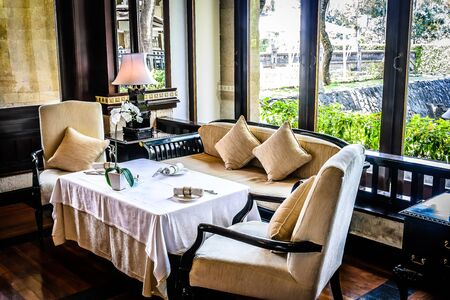 beautiful restaurant with white linen table cloths, white linen napkins and mother of pearl napkin holders