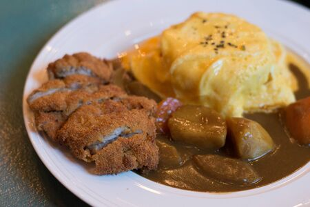 Japanese chicken curry with potatoes and egg omelette rice
