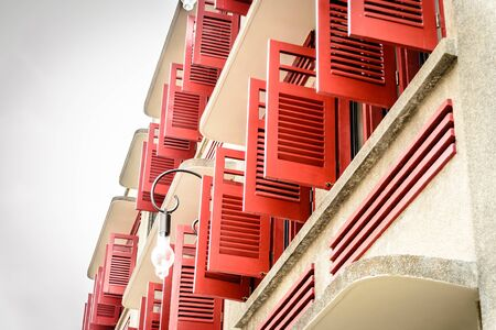 shophouse facade with red window shutters in Little India in Singapore