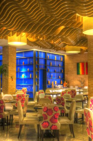 beautiful restaurant interior design with table seating and lighting and other furniture