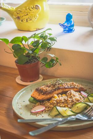 Sous vide miso salmon and avocado served with quinoa edamame salad