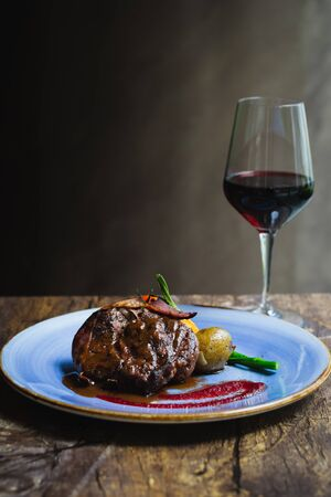 Alo Ribeye 250gm char-grilled ribeye with mashed potatoes & asparagus and a glass of red wine