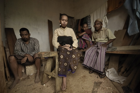 adult indonesia: MADURA, INDONESIA - NOVEMBER 24, 2008: Unidentified mentally-ill patients rest after their lunch in the Al-Bajigur mental asylum on November 24, 2008 in Sumenap, Madura, Indonesia.