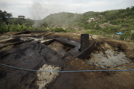 harmed: JAVA, INDONESIA - November 29, 2008: Environmental pollution and destruction caused by an illegal oil field on November 29, 2008 in Kadewan, East Java, Indonesia. Editorial