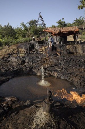 toxins: JAVA, INDONESIA - November 30, 2008: Environmental pollution and destruction caused by an illegal oil field on November 30, 2008 in Kadewan, East Java, Indonesia. Editorial