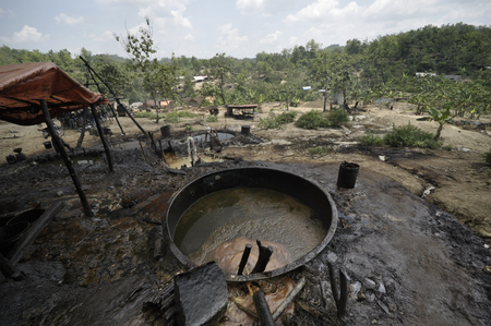 harmed: JAVA, INDONESIA - November 30, 2008: Environmental pollution and destruction caused by an illegal oil field on November 30, 2008 in Kadewan, East Java, Indonesia. Editorial