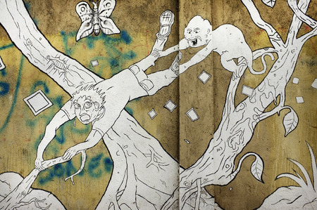 attacked: BALI, INDONESIA - December 24, 2015: Street art depicting a traveller being attacked by a monkey in a forest on December 24, 2015 in Ubud, Bali, Indonesia.