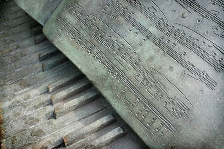 musical score: SINGAPORE CITY, SINGAPORE - January 25, 2106: The metal sculpture of a piano keyboard with the musical score of Chopins Polonaise on January 25, 2016 in the Singapore Botanic Gardens, Singapore. Editorial