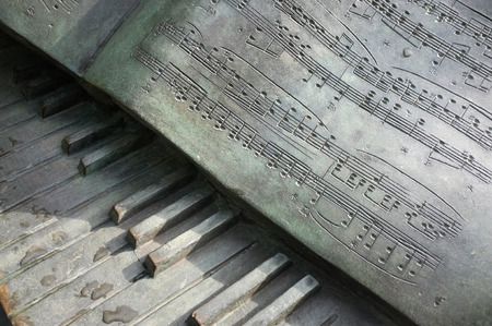metal sculpture: SINGAPORE - January 25, 2106: The metal sculpture of a piano keyboard with the musical score of Chopins Polonaise on January 25, 2016 in the Singapore Botanic Gardens, Singapore.