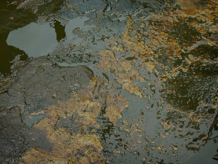 earth pollution: Carcinogenic crude oil pollution produced by illegal oil mining pollutes the water table in East Java, Indonesia.
