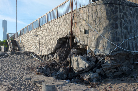 seminyak: BALI, INDONESIA - JUNE 23: The sea wall of a tourist restaurant and hotel lies damaged by freak waves and severe coastal erosion due to climate change on June 23, 2016 in Seminyak, Bali, Indonesia.
