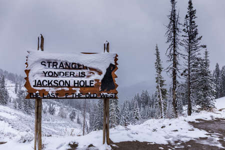 glory of the snow: A snow-covered welcome sign on Teton Pass Highway welcomes strangers to the small town of Jackson Hole, Wyoming