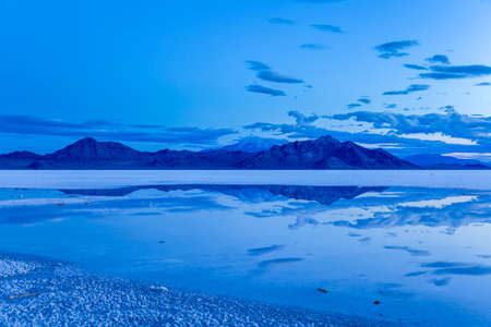 salt flat: The Silver Island Range is reflected in the salt flat at Bonneville Salt Flats just before sunrise