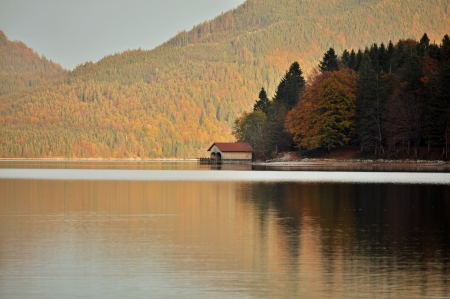 house by lake in autumn