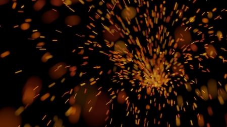 Red and orange sparks flying across a black background Imagens