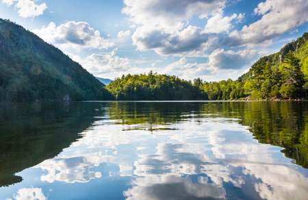 Beautiful reflection on chapel pond in the Adirondack region of New York Imagens