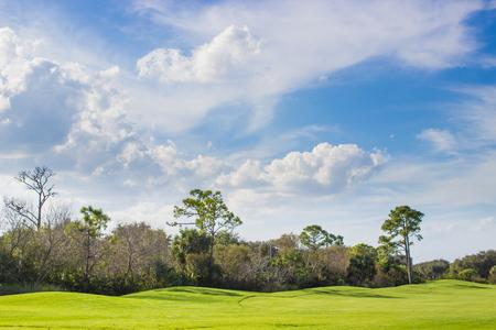 Pristine golf course under beautiful blue sky