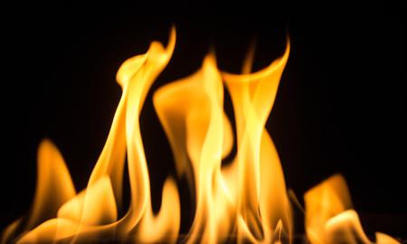 bright orange smokeless flame on a black background