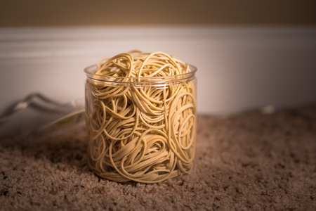 Clear bucket of Rubber bands