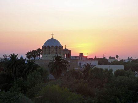 An amazing sunset beyond a church on Kos Island, Greece. Stock Photo - 3681600