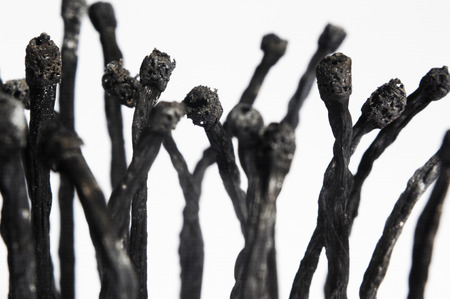 sculpted: An artistic representation of mass cremation, sculpted using burnt matches. Stock Photo