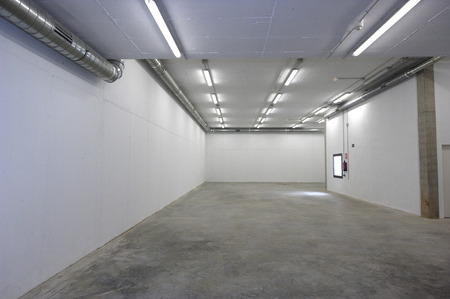 empty warehouse: or new empty warehouse room with nothing, white color, Stock Photo