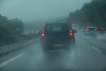 multiple lane highway: Rain, Driving, Windshield, Windshield Wiper, Car, Single Line, Window, Multiple Lane Highway, Road, Electric Light, Van - Vehicle, Commercial Land Vehicle, Personal Land Vehicle, Land Vehicle, Headlight, Tail Light, Wet, Dirty, Lighting Equipment, Torrent
