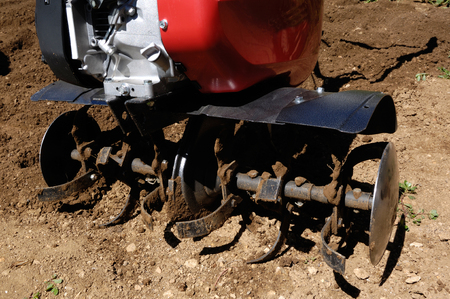 cultivator: detail, Cultivator on a field. Stock Photo
