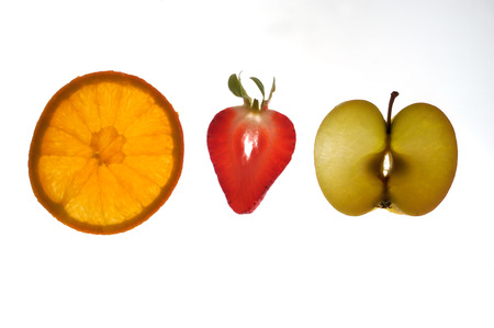 sectioned: various sectioned and white fruit,apple, orange,strawberry,
