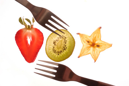 sectioned: various sectioned and white fruit,strawberry, kiwi, star fruit,