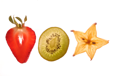 sectioned: various sectioned and white fruit,strawberry, kiwi, star fruit Stock Photo