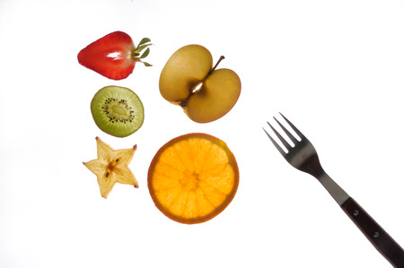 sectioned: various sectioned and white fruit, strawberry, kiwi, star fruit