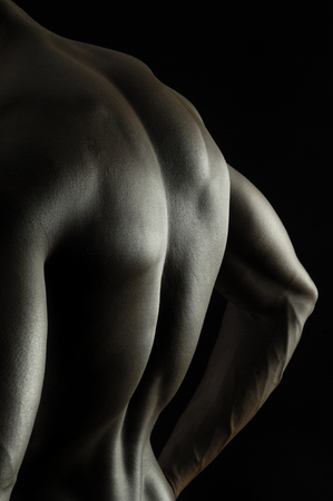 naked african: back of a naked African boy, black background Stock Photo