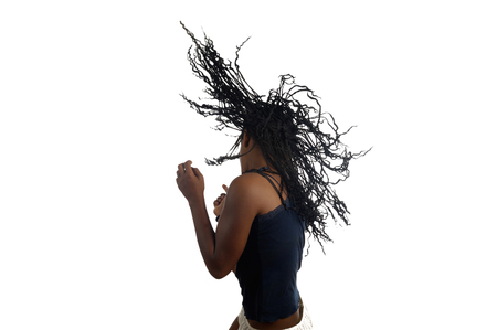 moving activity: Young black teenager woman dancing , isolated