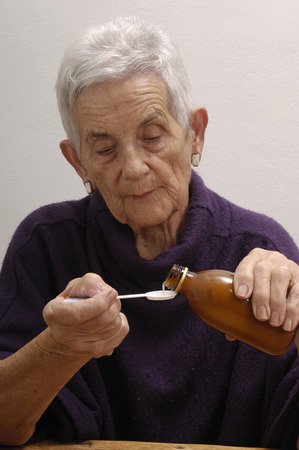 jarabe: senior woman taking syrup