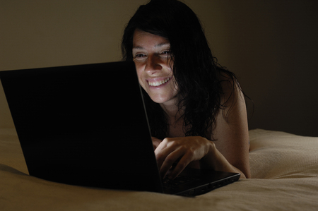 caucasion: Woman with computer in bed