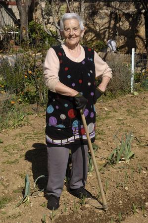 incidental people: old woman in garden